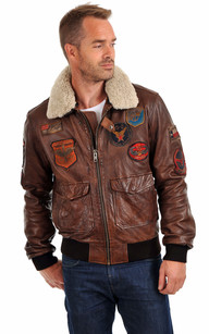 Blouson definition, a woman's outer garment having a drawstring, belt, or similar closing, at or below the waist, which causes it to blouse. See more.